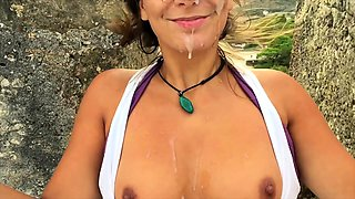 Naughty tanned busty blonde gives an amazing outdoor handjob