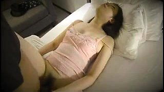 Sleeping Asian wife has a horny guy plowing her tight cunt