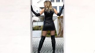Woman in short leather skirt and boots