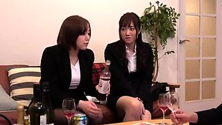 Two busty Japanese beauties sharing their passion for cock