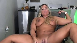 Hot muscular milf fucks her shaved pussy with a vibrator
