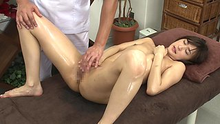 Cute Japanese babe oiled up by a man before a sexual game