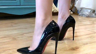 My nude feet inside black high heels