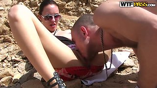 Dirty brunette Aurita gets licked on the beach