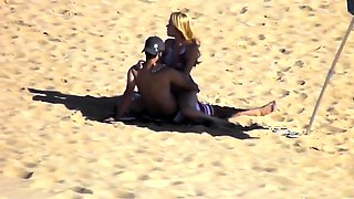 Voyeur finds a horny amateur couple having sex on the beach