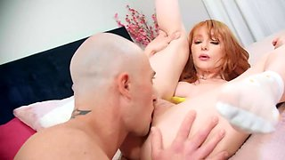 Redheaded goddess gives amazing head and has intense sex