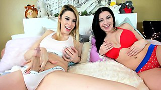 Beautiful shemale has a busty brunette girl sucking her cock