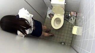 Slender Japanese beauty sucks and fucks in a public toilet