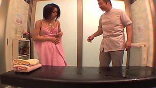 Voyeur camera films a Japanese babe enjoying a hot massage