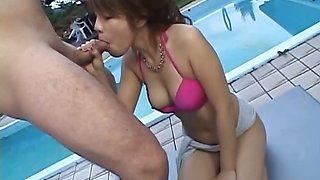Japanese hottie sucks off three cocks by the pool