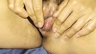 Thai Milf plays with her pussy