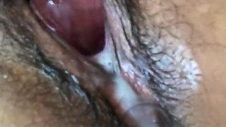 Philippino girl making her hairy pussy very wet