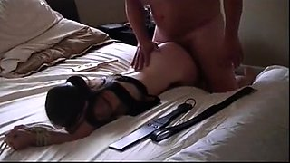 Submissive brunette gets spanked and fucked rough doggystyle