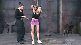 Leggy busty babe is punished by kinky mistress