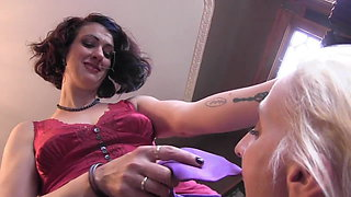 Kinky brunette bangs tattooed young blonde with a strap on