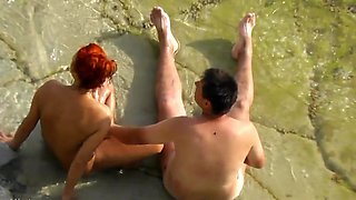 Voyeur. Guy wanking and fuck redhead girl on a public beach