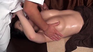 Asian oiled up slut gives massage blowjob to big cock