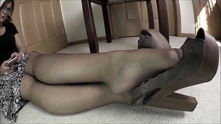 Smelling feet in pantyhose
