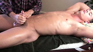 American hunk gets his cock jerked by masseur