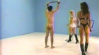 Erotic whipping with two naked mistress