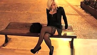 Hot blonde in high heels and stockings