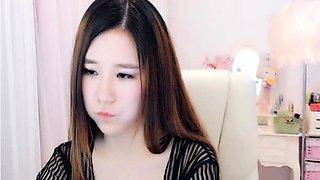 Ravishing Korean teen fingers her wet honey hole on webcam