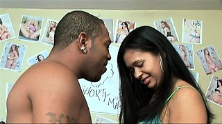 Luscious brunette recruits a black stud to satisfy her needs