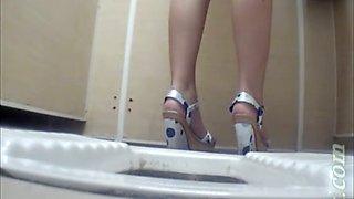 Fine white stranger girl in high heel shoes filmed pissing in the toilet