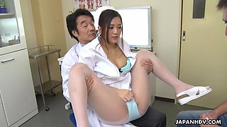 Young Japanese nurse Anna Kimijima gives a blowjob to patient in front of physician