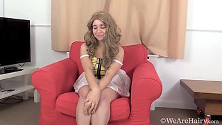 Dolores Maria strips naked on her red chair - WeAreHairy