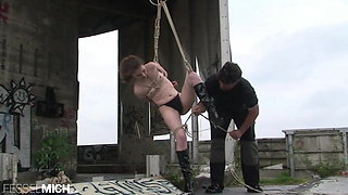 Naked slave girl tied in suspension bondage and with ropes