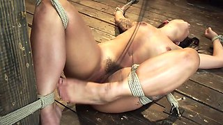 Tied and naked girl is waiting for a punishment on that cold floor