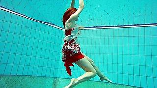 Hairy brunette teen Marketa underwater flirting