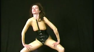 Brown haired lady is flexible