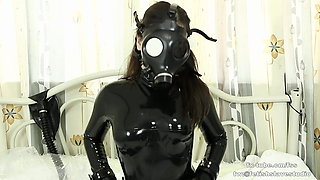 Cute Latex girl  breathplay with cuffs on bed