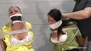 Two busty females chairtied
