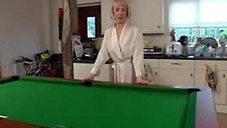 Hazel poses on the pool table