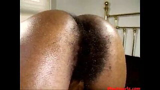 The dark pubic hair on the big ass of a black woman is obscene