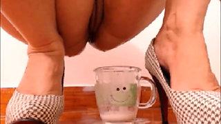 Latin filling the glass of creamy milk