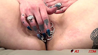 Big titty Tattooed MILF shows off her pussy piercings