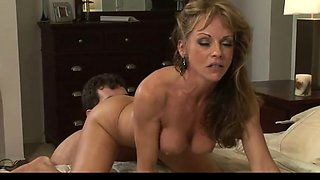 Mature hot mom with junior man in bedroom
