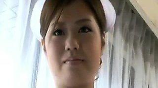 Provocative Japanese nurse sensually exposes her wonderful