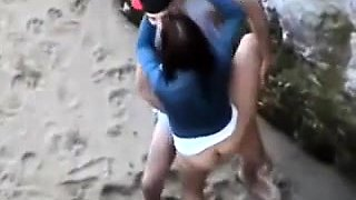 Wild brunette girlfriend gets banged doggystyle on the beach