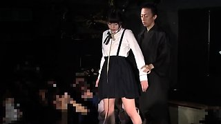 Adorable Japanese schoolgirl tied up and suspended in public