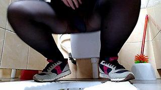 Milf pissing in public toilet