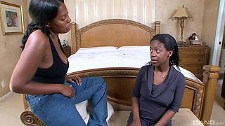 Ebony lesbians drop their clothes to have sex with a large strapon