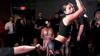 Tied up chick is humiliated and flogged in front of this crowd
