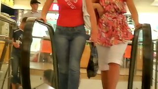 Slim tanned hot brunette with camel toe shopping street candid