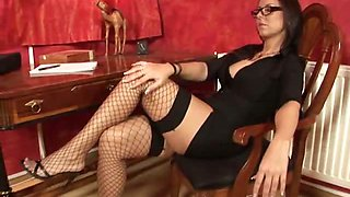 good looking office babe in fishnets